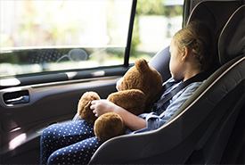 A young girl in a car seat