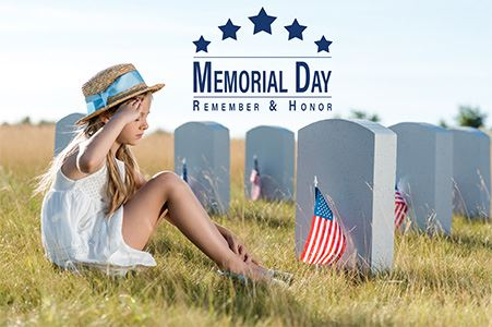 Memorial Day - Remember and Honor. Young girl sitting at a grave saluting. A small American flag sit